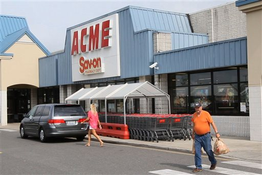 Shoppers walk outside an Acme store on Route 9 in Little Egg Harbor, N.J., where one of the winning lottery tickets in the $448 million Powerball drawing last night was sold, Thursday, Aug. 8, 2013. (AP Photo/The Asbury Park Press, Bob Bielk)
