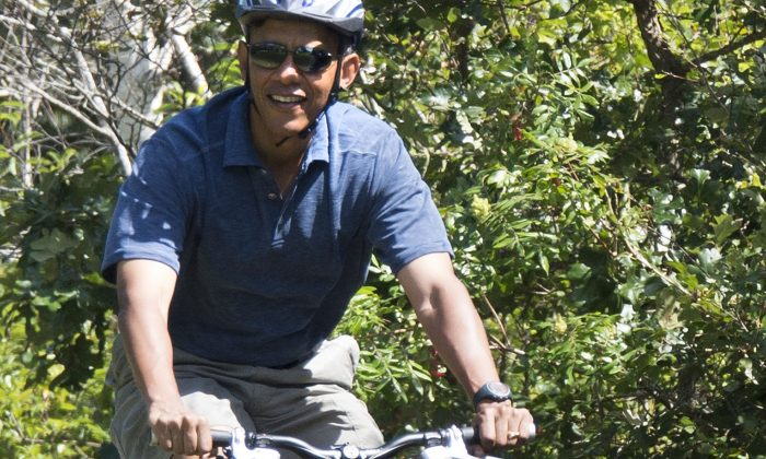 The photo in question shows President Obama on a bike Manuel F. Correllus State Forest in West Tisbury, Massachusetts on Friday. NY Magazine questioned the bumps on his leg. (JIM WATSON/AFP/Getty Images)