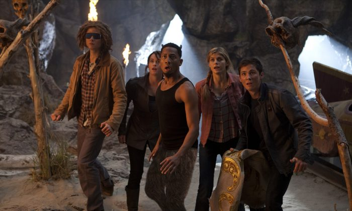 (L–R) Tyson (Douglas Smith), Clarisse (Leven Rambin), Grover (Brandon T. Jackson), Annabeth (Alexandra Daddario), and Percy (Logan Lerman) are shocked by their latest discovery. (Murray Close/ Twentieth Century Fox Film Corporation)