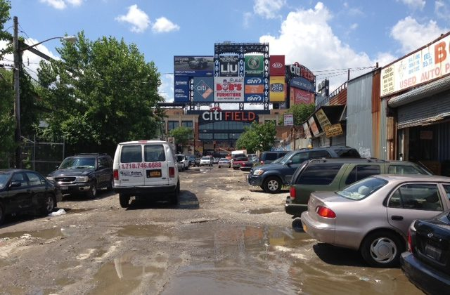 Auto repair shops line a Willets Point street leading to the Citi Field bullpen gate on August 2, 2013. (Ivan Pentchoukov/Epoch Times)