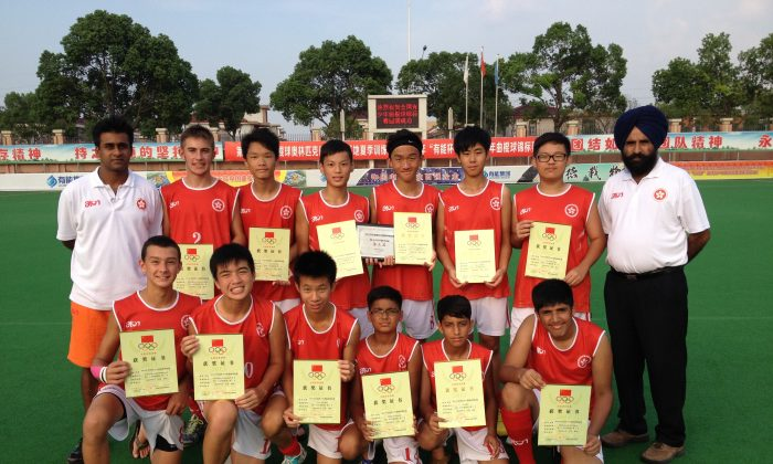 Bronze finish.....Hong Kong youth hockey team proudly show their bronze award from the 5th Youth Hockey International Championship, in YangZhong, China on Aug 26. (Gurcharan Singh)