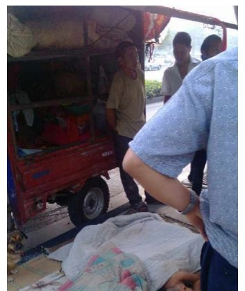 Screenshot showing Li Donghong on the side of the road with his modified tricycle and some of the boys. (Screenshot/Epoch Times)