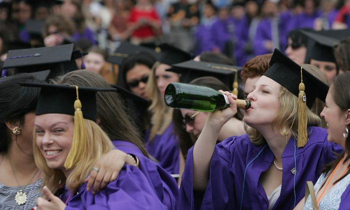 A file photo of New York University College of Arts and Science graduates celebrating at a graduation ceremony in Washington Square Park. (Mario Tama/Getty Images)