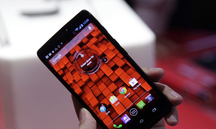 Verizon's Motorola Droid Ultra smartphone. The union representing Telus and Shaw workers is adding its voice to the growing opposition against the U.S. telecom giant's possible entry into Canada's wireless market. (AP Photo/Mark Lennihan)