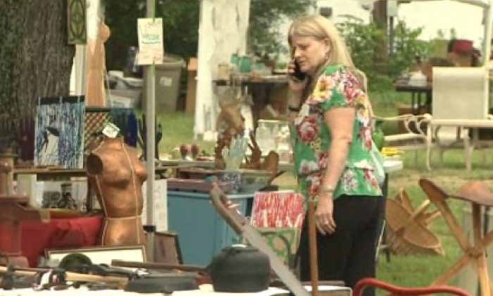 A screenshot of WVLT in Knoxville shows the yard sale.