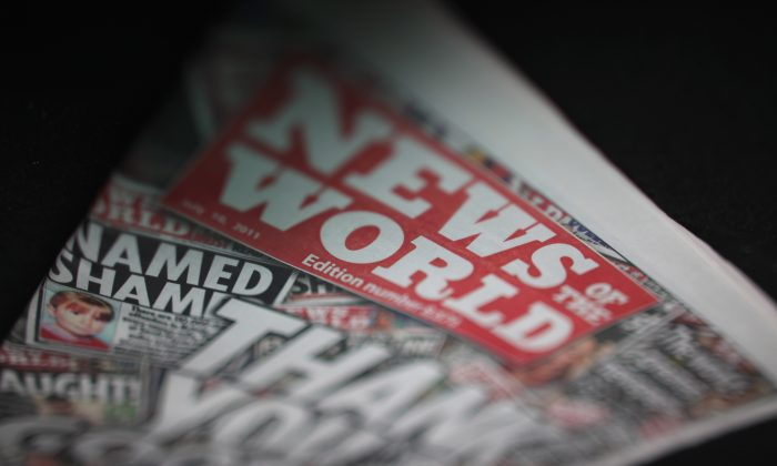 A copy of the last-ever News of The World newspaper for sale at a newsagents in central Manchester, England, on July 10, 2011. The 168-year-old newspaper was closed amid phone hacking and bribery allegations. (Christopher Furlong/Getty Images)