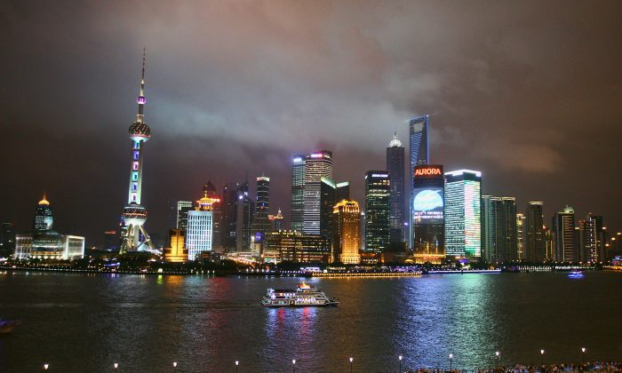 A sightseeing ship on the Huangpu River against the night skyline of Pudongs Lujiazui Financial District in Shanghai, China on July 15, 2011. (Feng Li/Getty Images)