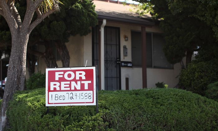 A 'for rent' sign is posted in front of a house on June 15, 2012 in Richmond, California. (Justin Sullivan/Getty Images)
