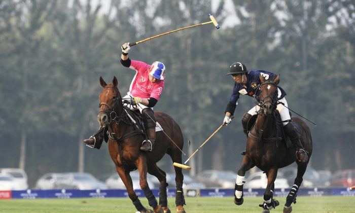 This picture taken on Sept. 23, 2012 shows competitors from Thailand (L) and China fighting for the ball during the Royal Salute Gold Cup 2012 China Open polo tournament in Beijing. China's wealthiest want their children to learn to play polo as preparation for leaving China and living in the West. (Wang Zhao/AFP/GettyImages)