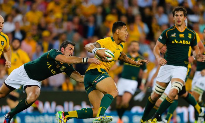 When last they met ... Australian Wallaby fullback Israel Folau is tackled by South African Springbok scrum half Francois Louw during their Rugby Championship match at Suncorp Stadium in Brisbane on September 7, 2013. The 'Boks won 12-38 and will be looking to win again when they meet on Saturday night in South Africa. (PATRICK HAMILTON/AFP/Getty Images)