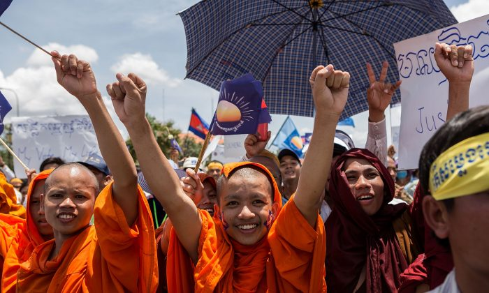 Supporters of the Cambodia National Rescue Party show their support in Freedom Park, Sept. 7 in Phnom Penh, Cambodia. Thousands rallied to challenge Prime Minister Hun Sen's disputed election win. (Nicolas Axelrod/Getty Images)