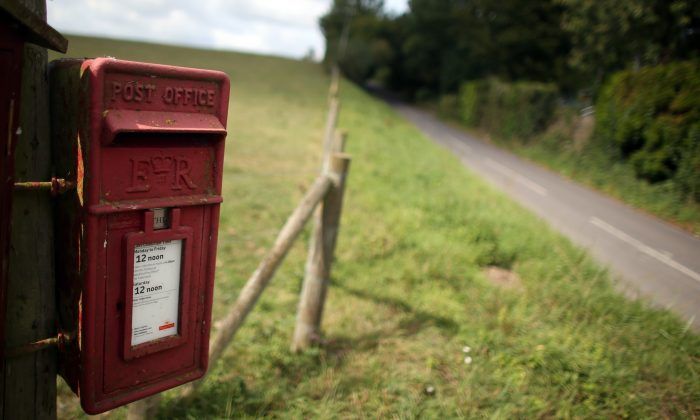 The planned privatization of the Royal Mail will not result in worse service and will instead improve it, says a UK parliament member. Here a Royal Mail post box is beside a country land near Poole in Dorset, England. (Matt Cardy/Getty Images)