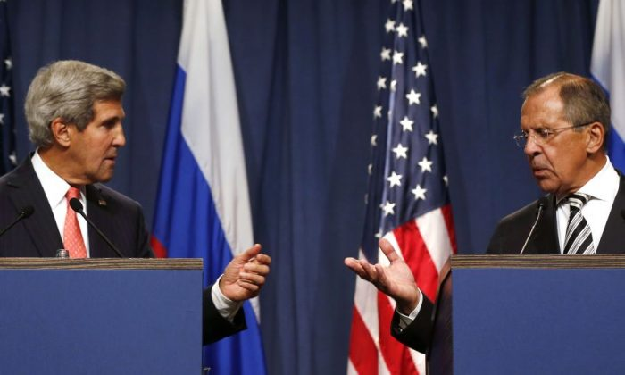 U..S Secretary of State John Kerry (L) at a joint press conference with Russian Foreign Minister Sergei Lavrov in Geneva, Sept. 14. (Larry Downing/AFP/Getty Images)