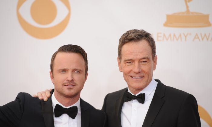 Breaking Bad actors Bryan Cranston (R) and Aaron Paul (L) arrive on the red carpet for the 65th Emmy Awards in Los Angeles, California, on September 22, 2013. (Robyn Beck/AFP/Getty Images)