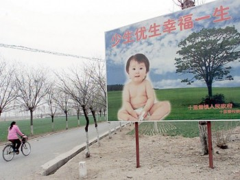 """A roadside billboard put up by China's Family Planning Office reads: """"Fewer, healthier births will bring a lifetime of happiness."""" (AFP/Getty Images)"""