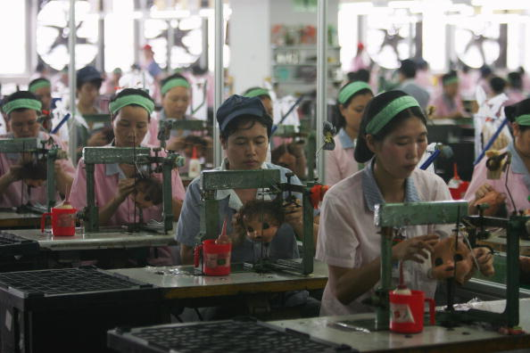 Workers assemble dolls at Jetta Industries Co., Ltd. in Guangzhou, China, Sept. 4, 2007. (Feng Li/Getty Images)
