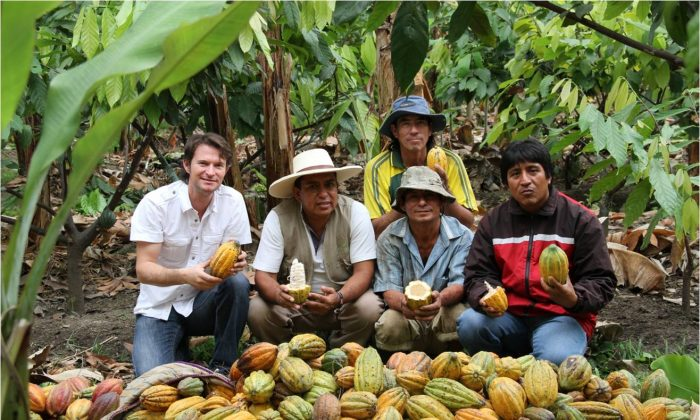 Santiago Peralta (L), co-founder of Pacari, with cacao farmers. (Courtesy of Pacari)