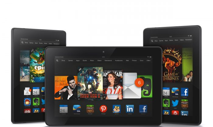 The new 8.9-inch Amazon Kindle HDX tablet computer, center, the 7-inch Kindle HDX, left, and the updated Kindle HD. (AP Photo/Amazon.com)