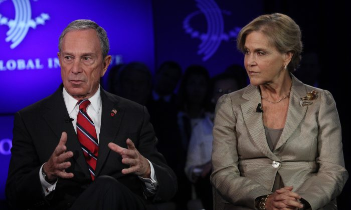 Mayor Michael Bloomberg (L) and Judith Rodin, president of the Rockefeller Foundation, attend the Clinton Global Initiative in New York City, Sept. 25, 2013. (Mehdi Taamallah/AFP/Getty Images)