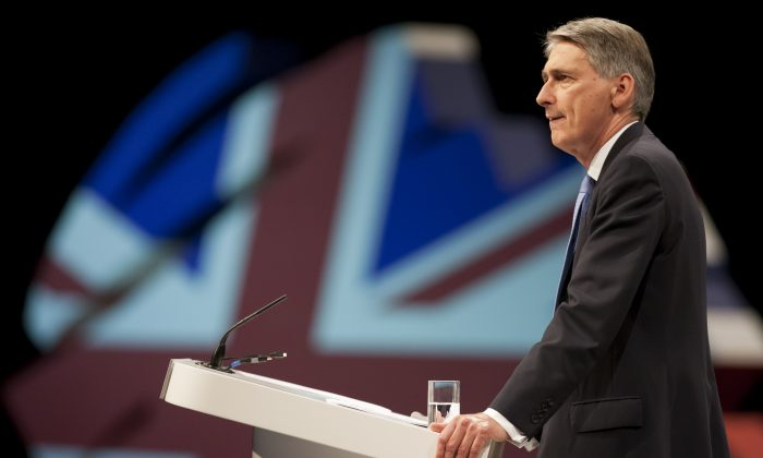 Defense Secretary Philip Hammond speaks at Britain's Conservative Party Conference, Manchester, England, Sunday, Sept. 29, 2013. (AP Photo/Jon Super)