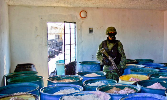 A soldier stands guard inside a clandestine chemical drug processing laboratory discovered in Mexico on Feb. 9, 2012. Chinese gangs are supplying Mexican drug cartels with chemicals to create illicit substances, for sale in the United States. (Hector Guerrero/AFP/Getty Images)