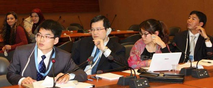 """The Chinese delegation made its presence known in March at a side event about human rights in China held at the United Nations. The tossing of a microphone placed upon their table was remarked upon as """"discourteous"""" by a media observer. (Courtesy of Ethan Gutmann)"""