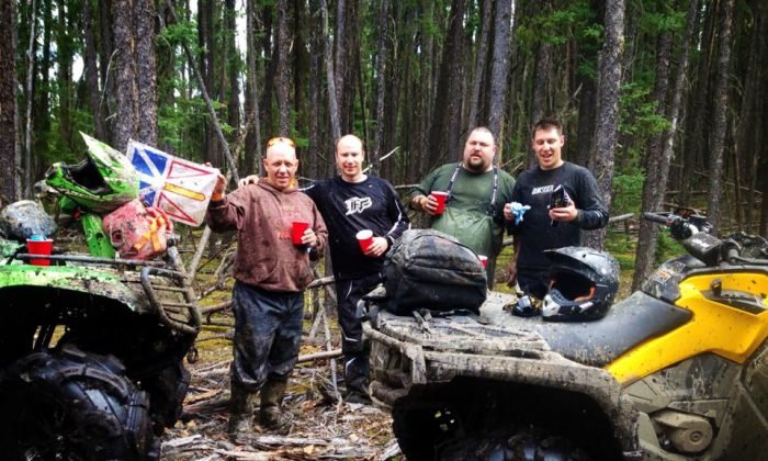 Steve Anderson (C) enjoys some ATV action with friends in Fort McMurray—just like back home in Newfoundland. Despite having a little community of fellow Newfoundlanders around him in Fort McMurray, Alberta, Canada, Anderson says it's not a good place to raise a child. Many from Canada's easternmost island province of Newfoundland make the long commute to the oil sands out west, leaving wives and children back home. (Courtesy of Steve Anderson)