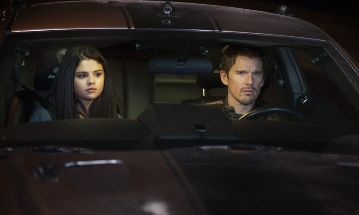 """Selena Gomez as The Kid and Ethan Hawke as Brent Magna in Warner Bros. Pictures and Dark Castle Entertainment's """"Getaway."""" (SIMON VARSANO/ Copyright 2013 ADF ACQUISITIONS, LLC)"""