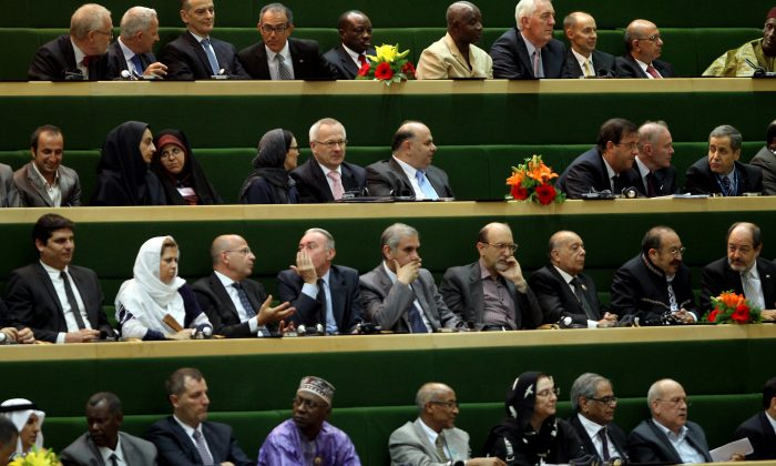 Foreign guests attend the swearing-in ceremony of Iran's new president Hasan Rowhani at the parliament in Tehran on Aug. 4, 2013. The Islamic republic's new president revealed a cabinet lineup of experienced technocrats, aiming to deliver on his promise of saving the economy and engaging the world. (Atta Kenare/AFP/Getty Images)