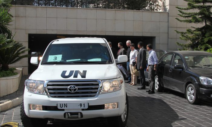 U.N. inspectors leave a Damascus hotel to go to the site of a chemical weapons attack, Aug. 28. (STR/AFP/Getty Images)
