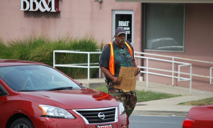 Marcellous Jackson, age 64, panhandles in Wheaton, Md. (Photo/ Ron Dory, Epoch Times)