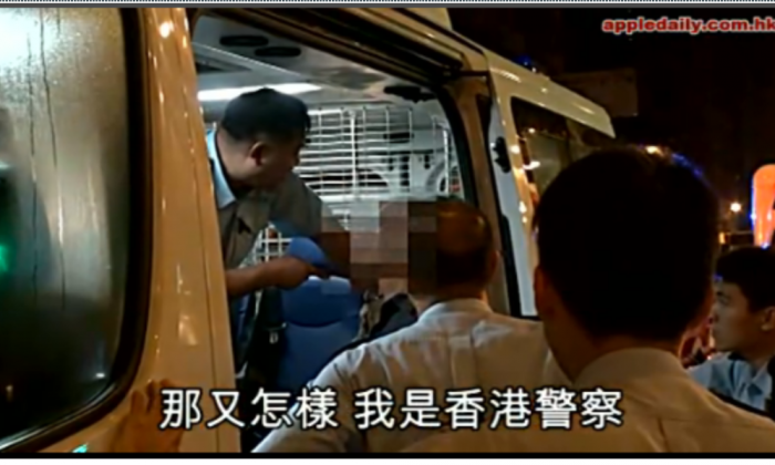 This screen grab from a video posted by Apple Daily shows an alleged drunk driver from the mainland who had loudly declared he was a Communist Party member being questioned by Hong Kong police. The video would be watched 300,000 times the first day it was posted. (Epoch Times)