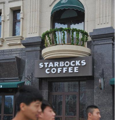 "There's nothing like a hot cup of ""Starbocks."" Many international name brands are pirated, but deliberately misspelled, in the Olympic Sport Center Wanda Plaza in China's Liaoning Province. (Screenshot/Money.163.com)"