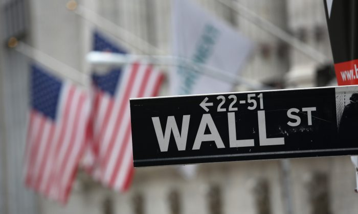 Wall Street outside the New York Stock Exchange on Sept. 16, 2013. Five years after the beginning of the financial crisis marked by the bankruptcy of Lehman Brothers, Wall Street has more than recovered its losses, although unemployment in the United States remains high. (John Moore/Getty Images)