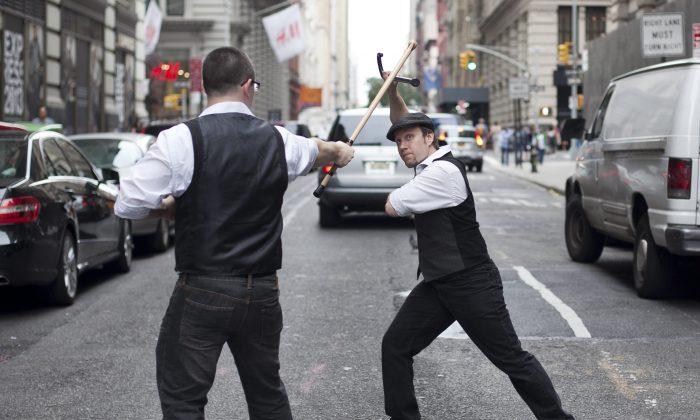 (L) Brad Gibson (R) Jesse Barnick combating in Bartitsu on 18th Street, New York City, Aug. 18. (Samira Bouaou/Epoch Times)