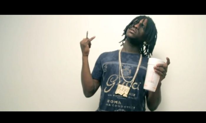 A screenshot of YouTube shows rapper Chief Keef.