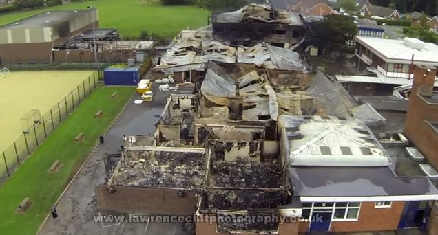 The St. Mary's Catholic Technology College buildings on September 2, 2013, after a fire that started burning a day prior spread quickly and burned much of the interior. This aerial view of the college, in Leyland in Lancashire, England is shot from a quadracopter, and is published here courtesy of Lawrence Clift Photography. (Screenshot/YouTube)