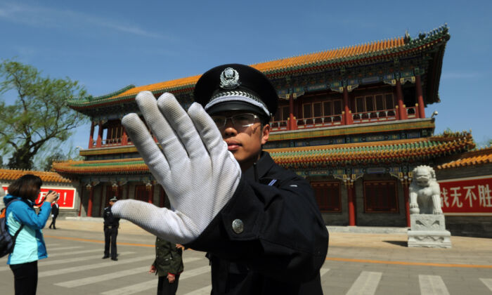 In this file photo, a policeman blocks photos from being taken outside Zhongnanhai, the central headquarters for the communist regime in Beijing. (Mark Ralston/AFP/Getty Images)