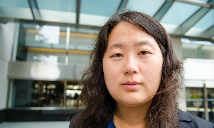 Toronto resident Jin Rong stands outside the Ontario Superior Court Wednesday after testifying about former Chinese official Bo Xilai's culpability in her illegal detention and torture in China in 2000. (Matthew Little/Epoch Times)