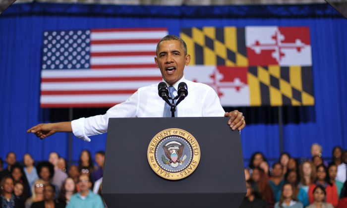 President Barack Obama speaks about the Affordable Care Act at Prince Georges Community College on September 26, 2013 in Largo, Maryland. On October 1, 2013, open enrollment starts for the new Obamacare online, state-based exchanges, where consumers will be able to compare and shop for private health insurance plans. (MANDEL NGAN/AFP/Getty Images)