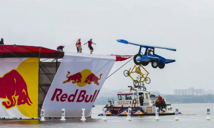 First place team Harvest Bureau from New Holland, Pennsylvania launch their ' angry tractor with wings' off of the 24 foot high platform at the National Red Bull Flugtag DC at the National Harbor on Sept. 21. ( Photo/ Red Bull USA)