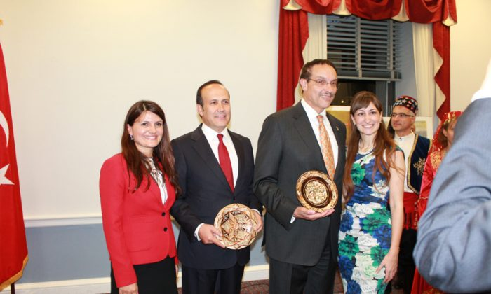 DC Mayor Vincent Gray and Namik Tan, Ambassador of Turkey, pose for a photograph with Demet Cabbar (left) and Salcigil White who are with the American Turkish Association of Washington, D.C. at the opening reception for Turkish Cultural Heritage Month on Capitol Hill Sept. 9 (Tiffany Wu/ Epoch Times)