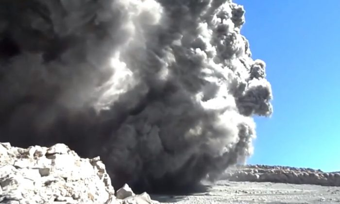 A screenshot of YouTube footage shows the volcano eruption.