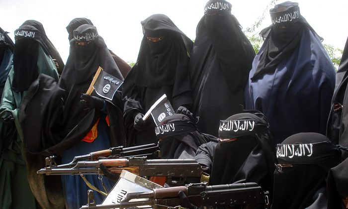 Somali women carry weapons during a demonstration organized by the extremist group al-Shabab in the Suqa Holaha neighborhood of Mogadishu, on July 5, 2010. (Abdurashid Abikar/AFP/File Photo via Getty Images)