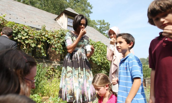 First lady Michelle Obama tries herbs with Turkish first lady Hayrunnisa Gul and students from JFK Magnet School and Pocantico Hills Central School in Westchester County, New York, on Sept. 24, 2010. (Hiroko Masuike/Getty Images)