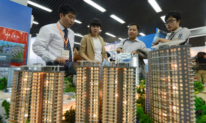 People view a model of a property development being sold at the Beijing Property and Investment Show in China on Sept. 20, 2012.  (Mark Ralston/AFP/GettyImages)