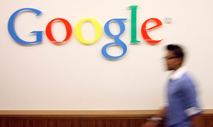 A visitor passes the Google logo at the Google offices in Berlin, Germany. (Adam Berry/Getty Images)