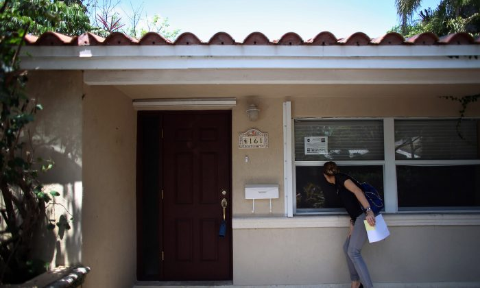 A real estate agent examines some property in this file photo. The biggest factors that affect the home appraisal include neighborhood, style of the home, and overall renovations. ( Joe Raedle/Getty Images)