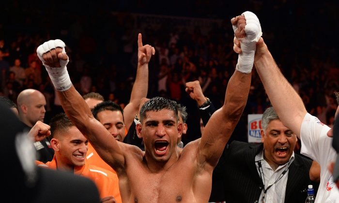 Amir Khan of Great Britain (C) reacts after defeating Julio Diaz of Mexico during their 143lbs Catchweight Contest at the Motorpoint Arena in Sheffield, England on April 27, 2013. (ANDREW YATES/AFP/Getty Images)