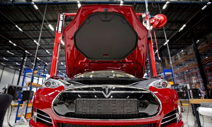 A Tesla electric car on an assembly line in the Netherlands, Aug. 22. (Guus Schoonewille/AFP/Getty Images)